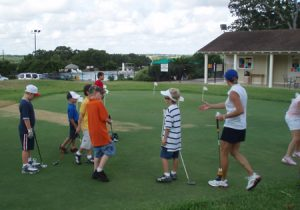 Junior golf kids getting lessons from pga instructors