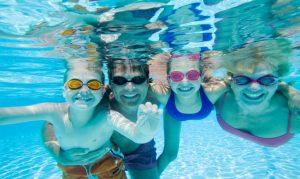 Family enjoys pool at Brenham Country Club